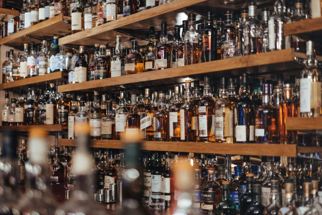 Wall of alcohol. Often alcohol abuse is a symptom of depression in men.