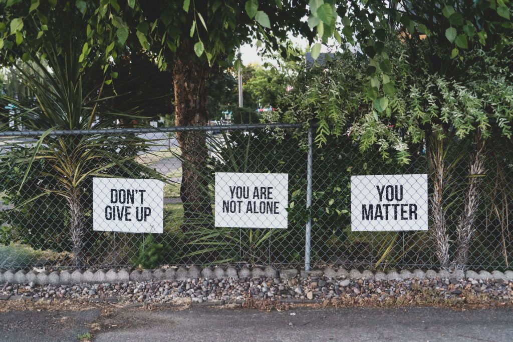 Three signs that read:
